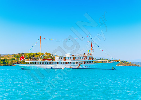 Old classic traditional white boat out of Spetses island in Greece
