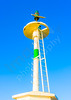The green navigation light loacated in the entry of the port of Nafplio town in Greece