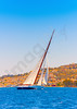 A really beautiful big old classic wooden racing sailing boat during a Classic Boats Regatta in Spetses island in Greece