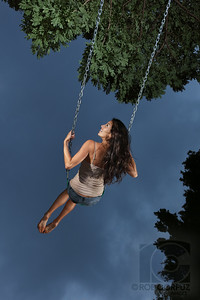 "SWING (original) - Honolulu, Hawai'i, USA  MOBI PCS ""FREEDOM""  In January, 2010, I did a commercial shoot for Mobi PCS, a cell/mobile phone coverage provider based in Honolulu. I've included the final versions of the ads, as well as the original images I submitted. The original concepts weren't mine, but the creative team at Mobi was very open to hearing my take on things, which was great. Although we had a short window for the shooting (six locations on different parts of Oahu in three consecutive days), and some bad weather (well, bad by Hawai'i standards anyway), overall I thought it went pretty well. However, there are ALWAYS things you wish you could've changed after the fact.   The plan all along was to rotate the images 90 degrees, and the largest output was going to be 8 by 4 foot prints (2.4m x 1.2m) so I had to shoot these with enough space to crop to a 2:1 aspect ratio yet keep the crucial elements big enough to get enough resolution for the large final output. However, at the last minute, Mobi decided to go with a 45 degree rotation instead, and a re-shoot was not possible, which meant losing most of the original frame to cropping and LOTS of retouching to fill in gaps.   We ended up swapping out the background of two shots: the new ""Dock"" background was taken from another frame from the same shoot in order to fit the final layout, and the ""Swing"" background was eventually replaced by a photo I had shot a couple of months earlier in the Philippines, as it was actually raining while the shot was taken and the moody sky present wasn't what they were looking for. In the end, they decided to go with a different shot altogether for ""Swing"" which they felt fit better with the new background. While I wasn't that big of a fan of the pose and the lighting on the version they chose, I can understand their reasoning, and of course, it's their show:)  Still, I've decided to post what I did myself, with the original backgrounds, before the designers at Mobi did the final rotation, background switches, compositing, additional retouching to fill in blank spots, and added graphics and copy. My side of the post-processing involved color and contrast adjustment, retouching, and a dash of the contrast-masking/hi-pass effect. These shots are essentially what I submitted to Mobi (the replacement backgrounds aren't shown here), although I did add sharpening, a touch of vignetting, and slight crops (in a couple of cases) just before posting.    It was truly a pleasure working with Evan and Noa, who were both the brains and brawn behind this project, as well as all of our lovely models. Special kudos in particular go to Evan, who also happens to be my brother, which I'm sure is totally unrelated to me getting this assignment... hey, you gotta start somewhere, right? ;)"