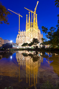 LA SAGRADA FAMILIA - Barcelona, Spain  I'd like to think that the reflection in the water represents Gaudi's vision, since the construction towers aren't quite as evident there.