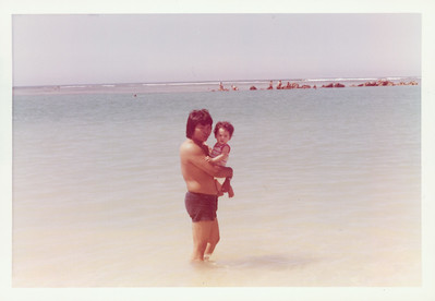Dad and I at the beach.  He used to joke that he would drop me in the water and leave me there so that I could learn to swim.  I wasn't amused by that.