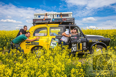 "HELPING HANDS ON HANNAH - Somewhere in France (I think...maybe)  These three Brits (from left to right: Johno, Leigh, and Paul) broke the Guinness World Record for the longest and highest (altitude) taxi cab ride.  And if that wasn't already awesome enough, they did it to raise money for charity.    Having bought a London black cab, affectionately christened ""Hard Hearted Hannah,"" they modified it to beef up the engine, add a shotgun seat and remove the barrier, not to mention installing a needlessly (and gloriously) deafening speaker system, and drove it through over one hundred countries on their way from London to Sydney.    I crossed paths with them in Kiev, Ukraine, and couldn't resist the invitation to catch a ride with them from Kiev to Lviv, and then on from Lviv to Krakow, Poland.   We were stopped by Ukrainian police at least five times along the way.  If I remember correctly, I was the first official fare of their journey.  Thankfully, the guys were kind enough to accept (in lieu of the meter price of £1035) a tank of petrol, a few beers, some pasta and bread, and a donation, through their website, to the British Red Cross.    More than a year later, I met up with them in Moscow and caught a lift again: this time stopping in Estonia, Latvia, Lithuania, Poland, Germany, Luxembourg, France, and the U.K.  They also asked me to be their photographer and document the last couple of weeks of their drive, and I was happy to oblige.    The last time I rode with them, I figured they might never make it back home without killing each other, but after driving all around the world since February, 2011, they finished their epic and ridiculous journey back in London on May 12th, 2012, after four different continents, more than fifty countries, well over a hundred passengers, four flat tires, 8000 liters of petrol, £20,000 raised for the British Red Cross, one Bollywood movie appearance, and a couple of bullet holes. You can find out more about their amazing journey and see lots more photos here."