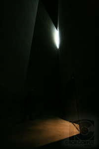 JEWISH MUSEUM - Berlin, Germany  This is the Tower of Terror.  As I understand it, it's intended to give a bleak, hopeless sensation.  There is light coming through a corner of the stark, harshly angled cavern, but it's a tease... far out of reach.