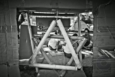 SOCIAL JUSTICE PROTEST - Tel-Aviv, Israel  This Star of David is made of taped-together cardboard.  When I shot this in late July, 2011, protesters were living in tents on Rothschild Boulevard in Tel-Aviv to call attention to the high cost of living (housing, in particular).  This demonstration grew, eventually becoming a movement consisting of hundreds of thousands protesters from different socio-economic backgrounds and religious faiths opposing the established social order and expanding gap between rich and poor in Israel.