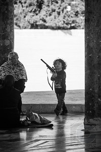 BOY WITH TOY GUN - Jerusalem, Israel  This was taken right next to the Dome of the Rock.