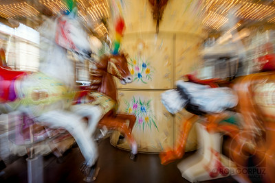 MERRY GO ROUND - Lucca, Italy  This effect was achieved by zooming the camera lens during the exposure.
