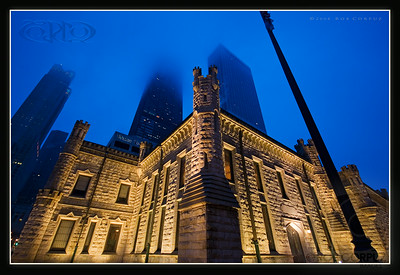 WATER TOWER IN FOG - Chicago, IL, USA  I didn't want to test the patience of my companions so I didn't set up for my tripod for this shot.  Normally I'd want to correct the severe perspective distortion, but I decided to leave this one basically as it came out of the camera (aside from sharpening and adding the frame and logo, I didn't change this shot at all).