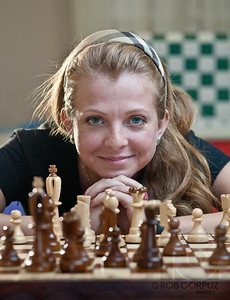 THE CHESS QUEEN - Usovo, Russia  Olga teaches chess.  Believe it or not, her eyes really are that color: that's not photoshop.  Shot with three speedlites: key in an umbrella camera-right, on-axis fill using a ring attachment, and a bare strobe (with an extra CTO gel) camera-left in the back of the room.