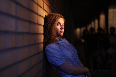LIGHTING UP A DARK ALLEY - Moscow, Russia  Lighting info: the key light is a small strobe in a snoot with a couple full cuts of CTO gel off-camera right on a light stand.  I had another speedlite on-camera with a big bounce (and, I think, a CTB gel) to provide some fill.  The columns in the back are lit pretty much entirely with ambient.  I wish I had used another strobe to give just a touch of rim light on the guys in the background.  I wouldn't want these shady characters to be entirely clear, but here I feel they are a bit too ambiguous.  As it is, I'm not even sure they're noticeable to most people.  Oh well.