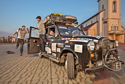 "FOLLOW THAT CAB - Just across the Ukrainian border of Poland  These three Brits (from left to right: Leigh, Paul and Johno) broke the Guinness World Record for the longest and highest (altitude) taxi cab ride.  And if that wasn't already awesome enough, they did it to raise money for charity.    Having bought a London black cab, affectionately christened ""Hard Hearted Hannah,"" they modified it to beef up the engine, add a shotgun seat and remove the barrier, not to mention installing a needlessly (and gloriously) deafening speaker system, and are driving it through over one hundred countries on their way from London to Sydney.    I crossed paths with them in Kiev, Ukraine, and couldn't resist the invitation to catch a ride with them from Kiev to Lviv, and then on from Lviv to Krakow, Poland.   We were stopped by Ukrainian police at least five times along the way.  If I remember correctly, I was the first official fare of their journey.  Thankfully, the guys were kind enough to accept (in lieu of the meter price of £1035) a tank of petrol, a few beers, some pasta and bread, and a donation, through their website, to the British Red Cross.    More than a year later, I met up with them in Moscow and caught a lift again: this time stopping in Estonia, Latvia, Lithuania, Poland, Germany, Luxembourg, France, and the U.K.  They also asked me to be their photographer and document the last couple of weeks of their drive, and I was happy to oblige.    The last time I rode with them, I figured they might never make it back home without killing each other, but after driving all around the world since February, 2011, they finished their epic and ridiculous journey back in London on May 12th, 2012, after four different continents, more than fifty countries, well over a hundred passengers, four flat tires, 8000 liters of petrol, £20,000 raised for the British Red Cross, one Bollywood movie appearance, and a couple of bullet holes. You can find out more about their amazing journey and see lots more photos here."