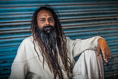 BEARDED MAN - Delhi, India  The available light was almost non-existent when I took this shot.  I used an on-camera flash pointed off to camera-left to bounce off a cart and boosted the exposure some in post.  After I showed him this picture, I guess he didn't like it because he asked me to take another one, but I think that this one ended up being better.