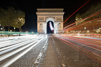 ARC DE TRAFIC - Paris, France  Here's a long exposure composite shot of the Arc de Triomphe taken on a night in Paris.  Note that this is probably not the safest spot to hang out and take pictures.