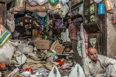 SHOPKEEPERS - Delhi, India  I came across these guys while wandering down a dark alley.