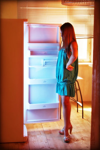 FRIDGE  For this shot I put two bare flashes inside the fridge (with double CTB gels) and set one speedlite in a shoot-through umbrella on a lightstand camera right (with a CTO gel), and set the camera's white balance to a warmer tone to try and get across the feel of opening a cool fridge on a hot day.  I nearly forgot to take the flashes out of the fridge at the end and had to wipe a bunch of condensation off of them.  Luckily they are still working (fingers crossed).  Thanks to Mila for modeling!