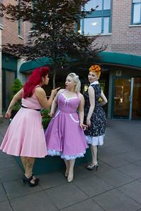 Three pinup models having fun at retro restaurant.