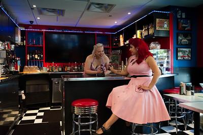 Two pinup girls having fun at a retro restaurant.