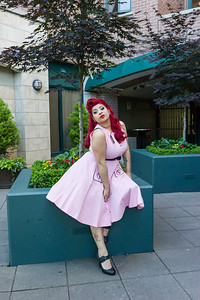 Pinup model outside on flower planter