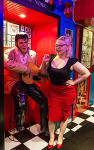 Pinup with Elvis statue