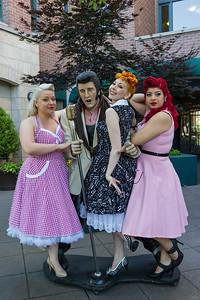 Pinup models having fun with Elvis