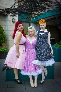 Three pinup models having fun at retro restaurant.