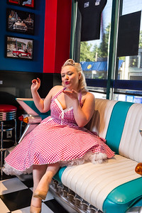 PInup model in chevy blowing kiss