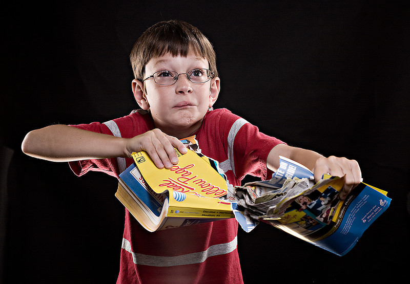 The phonebook is getting thiner each year. At this rate, even a little kid like Jake Crawford will be able to rip it apart without a fuss.<br /> Photo illustration for a story about fewer people using land lines and the phonebook being a little thiner each year.