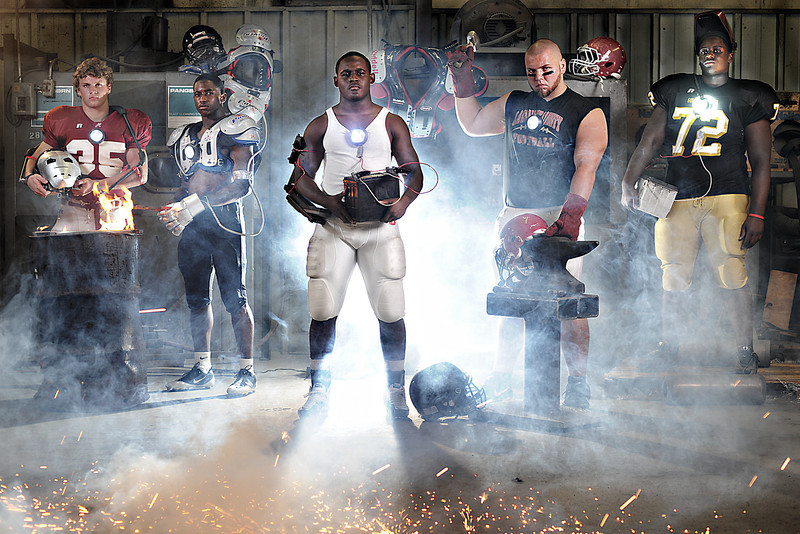"""IRONMEN""<br /> Picture for the cover of the High School football season preview.<br /> (L-R) Hartselle's Blaze Lawrimore, Austin's Seth Lynch, Decatur's Harold Swopes, Lawrence County's Adam Melson and Athens' Kamarine King."
