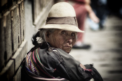 An old women in Peru stares directly at me as I take her picture