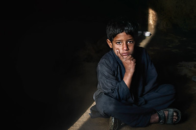 In the small Western Pakistan town of Yakmack I find this small chapati boy. He starts making chapati an hour before sunrise and stops and midnight.