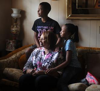 Arlester Gholston is raising her grandchildren, Hunter Mitchell and Emily Fuqua.