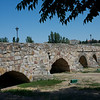 The 356 meter long Roman bridge over the Tormes River in Salamanca, Spain, a city of 154,000.  It was completed in the year 89 and served as an important part of the Roman silver route.