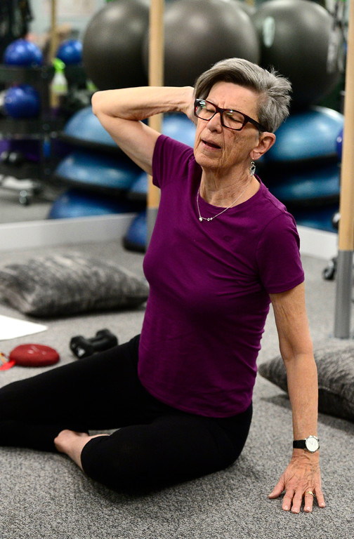 . Rosemary Wrzos works a side stretch in the Body Dynamics mend Posture Perfect Class in their Boulder facilities on Wednesday.  For more photos go to www.dailycamera.com Paul Aiken Staff Photographer April 12, 2017