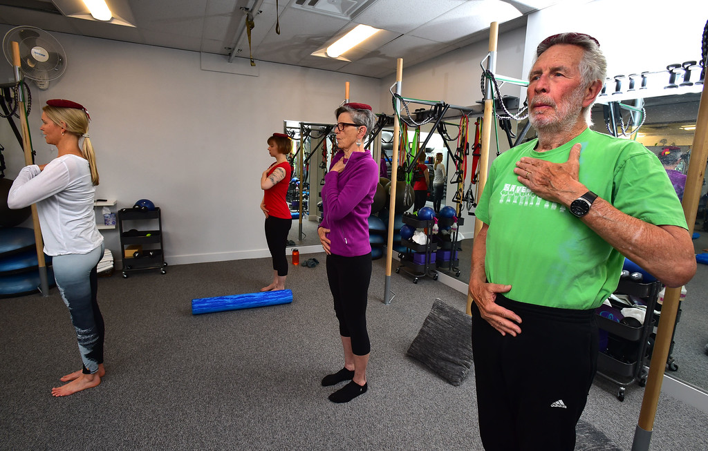 . Instructor Heli Ananda leads Dan Luecke and Rosemary Wrzos in a standing posture move in the Body Dynamics mend Posture Perfect Class in their Boulder facilities on Wednesday.  For more photos go to www.dailycamera.com Paul Aiken Staff Photographer April 12, 2017