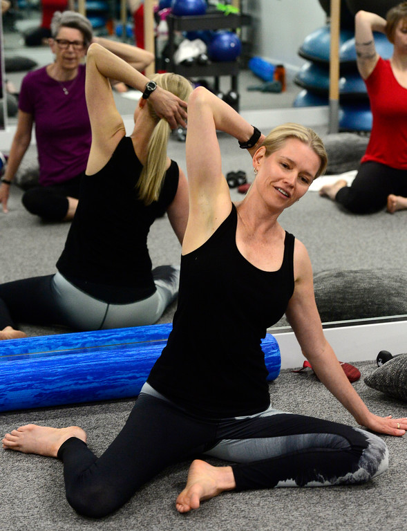 . Instructor Heli Ananda demonstrates a sidewards body stretch move in the Body Dynamics mend Posture Perfect Class in their Boulder facilities on Wednesday.  For more photos go to www.dailycamera.com Paul Aiken Staff Photographer April 12, 2017