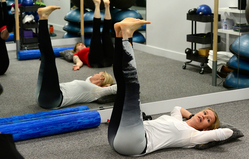 . Instructor Heli Ananda leads the class in the core strength section of in the Body Dynamics mend Posture Perfect Class in their Boulder facilities on Wednesday.  For more photos go to www.dailycamera.com Paul Aiken Staff Photographer April 12, 2017