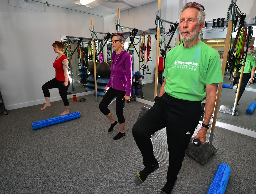 . Dan Luecke and Rosemary Wrzos work in in a one leg standing posture move in the Body Dynamics mend Posture Perfect Class in their Boulder facilities on Wednesday.  For more photos go to www.dailycamera.com Paul Aiken Staff Photographer April 12, 2017