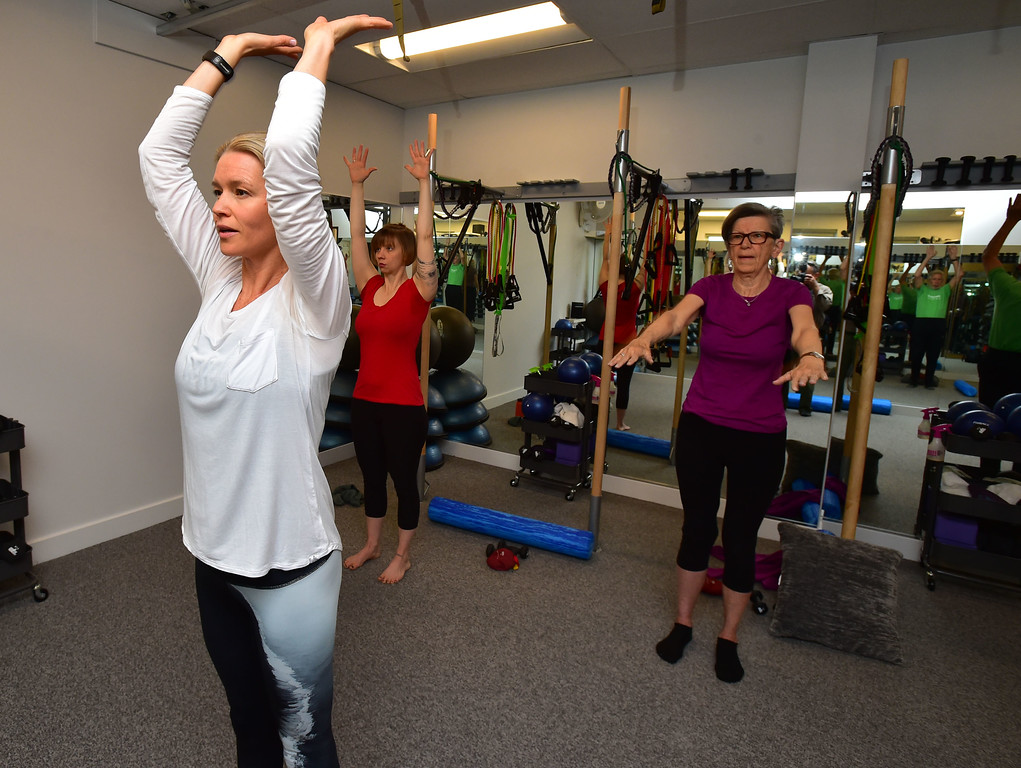 . Instructor Heli Ananda leads Rosemary Wrzos in a standing stretch move in the Body Dynamics mend Posture Perfect Class in their Boulder facilities on Wednesday.  For more photos go to www.dailycamera.com Paul Aiken Staff Photographer April 12, 2017