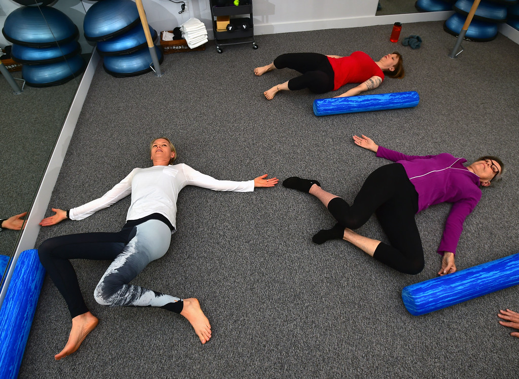 . Instructor Heli Ananda does a side twist stretch with client Rosemary Wrzos in the Body Dynamics mend Posture Perfect Class in their Boulder facilities on Wednesday.  For more photos go to www.dailycamera.com Paul Aiken Staff Photographer April 12, 2017