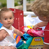 "Alex ""helping"" Hannah open presents"