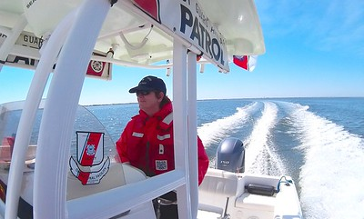 160514-G-WV696-594 SURF CITY, N.J. - Coxswain Laurie Huselton at the helm of her Auxiliary Vessel cuts through the blue waters of the Intracoastal Waterway (ICW) on the brisk and beautiful first day of the 2016 patrol season of District Fifth Northern. Coast Guard Auxiliary photo by Joseph Giannattasio.