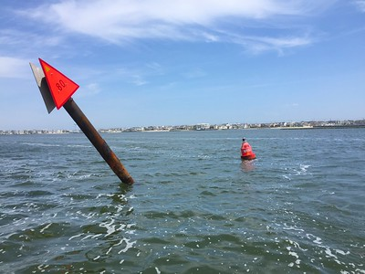 A leaning Daybeacon is marked with a Temporary Lighted Buoy on the Intracoastal Waterway off of Ship Bottom, NJ