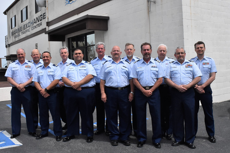 Ten Auxiliarists from U.S. Coast Guard Auxiliary District 11 Southern Region pose for a group photo after successfully completing a 16-hour Public Affairs Refresher Course at the Marine Exchange of Southern California, San Pedro, California, April 15, 2018.  Front left to right. Row 1: Patrick O'Driscoll, Fl 66; Josh Motley, Fl 4-10; Paul Saba, Fl 11-07; Gerald Myers, Fl 62; David Smith, Fl 49; and, Keith Touzin, Fl 12-04. Row 2: Commodore Harry Jacobs, ADSO-PA – Training (Instructor); Scott Hedblom, Fl 12-07; Douglas Bradford, Fl 96; Commodore Robert Holm, ANACO-FC; Commodore Bert Blanchette, IPDCO; and, Chief Public Affairs Officer, Michael Anderson, USCGR (Instructor). U.S. Coast Guard Auxiliary photo by Victoria Jacobs