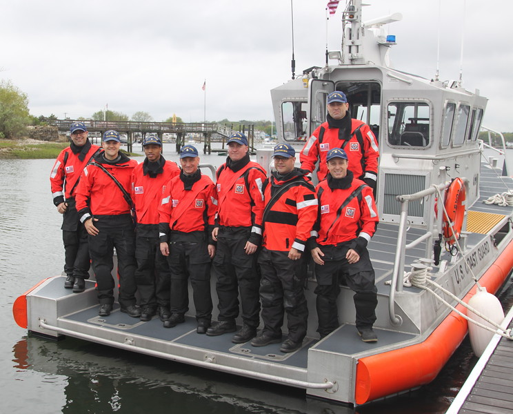 WESTPORT, CT: Crew aboard Coast Guard RBM 45733 pose for a group shot in her stern. They had just arrived at the Cedar Point Yacht Club's Open House event.  Photo By Peter Jensen, USCGAUX