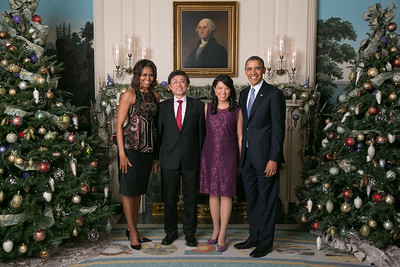 President Barack Obama and First Lady Michelle Obama greet Joy Lin and Don Lin during the Christmas holiday Press Reception #2 in the Diplomatic Reception Room of the White House, Dec. 18, 2013. (Official White House Photo by Amanda Lucidon) This photograph is provided by THE WHITE HOUSE as a courtesy and may be printed by the subject(s) in the photograph for personal use only. The photograph may not be manipulated in any way and may not otherwise be reproduced, disseminated or broadcast, without the written permission of the White House Photo Office. This photograph may not be used in any commercial or political materials, advertisements, emails, products, promotions that in any way suggests approval or endorsement of the President, the First Family, or the White House.
