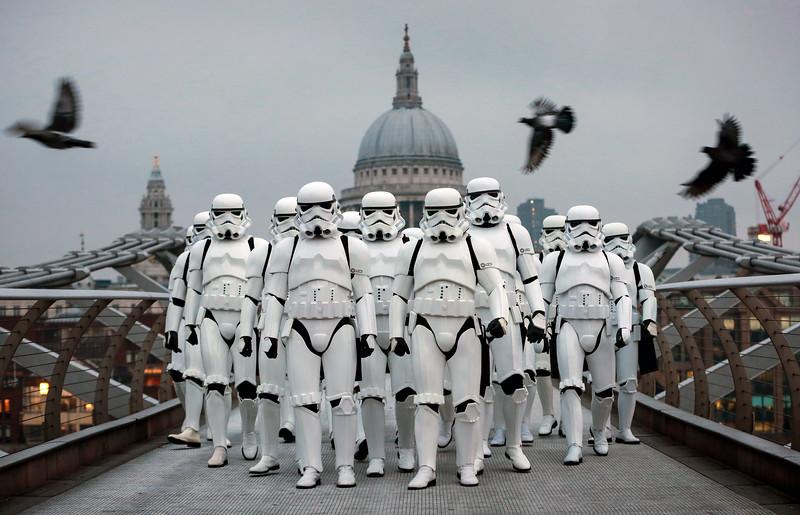 Stormtroopers walk across Millennium Bridge in advance of the new Disney film 'Rogue One'