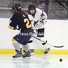 Chazy's Amanda Peterson, left, battles against Skaneateles at the Allyn Arena in Skateateles, N.Y., on Saturday, Feb. 13, 2010 Mike Okoniewski/P-R Photo