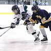 Chazy's Caitlyn LaPier battles for this puck against Skaneateles at the Allyn Arena in Skateateles, N.Y., on Saturday, Feb. 13, 2010. Mike Okoniewski/P-R Photo