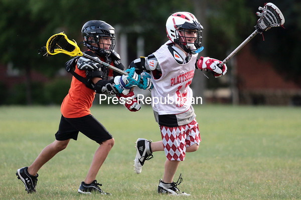 Monday, June 16, 2014. Members of the Plattsburgh Lacrosse Club's third and fourth-grade team practice at the U.S. Oval in Plattsburgh recently. In it's third year, the club serves youths from age 15 and under, helping them improve as athletes, individuals and team-players while maintaining the integrity of the sport. <br /><br />(P-R Photo/Gabe Dickens)