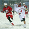 ROB FOUNTAIN/STAFF PHOTO  4-7-2016<br /> Plattsburgh plays St. Lawrence Wednesday during a men's lacrosse game at the Plattsburgh Fieldhouse.